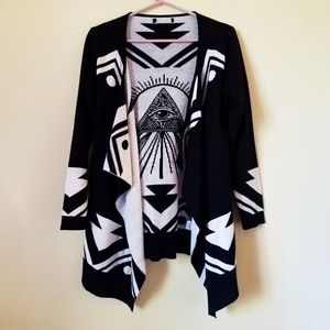 long, black and white patterned cardigan sweater